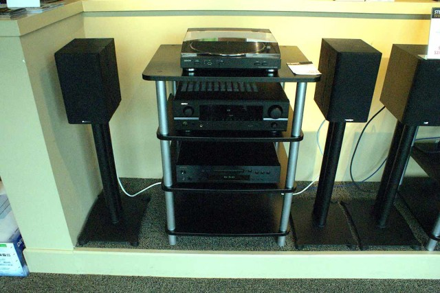 Example of a stereo system with speakers, receiver, CD player, turntable, and stand
